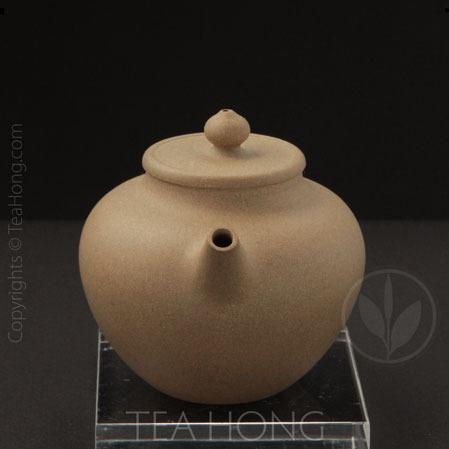 yu jian mei: flat lid lotus seed, front view