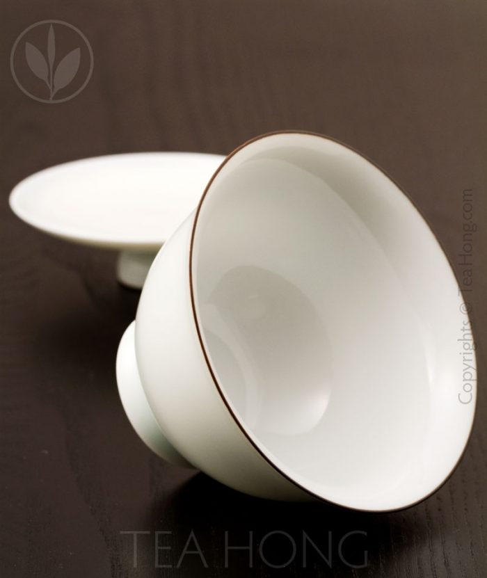 The interior of the gaiwan is also protected with a thick overglaze but reveals the natural white of the kaolin porcelain