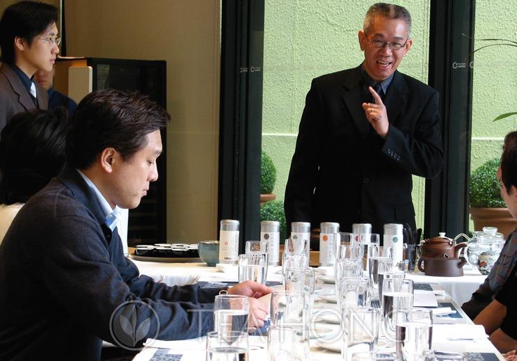 Leo presents tea to Yuji Wakiya