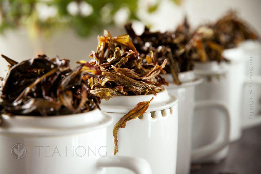 Infused leaves on tasters' mugs