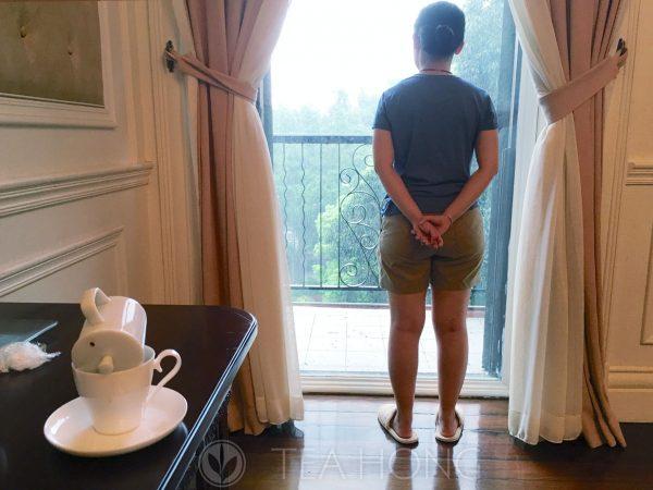 Olivia at the hotel window