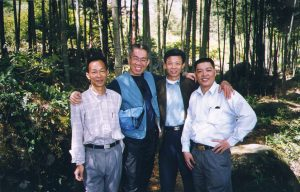 Leo with tea farmers in China