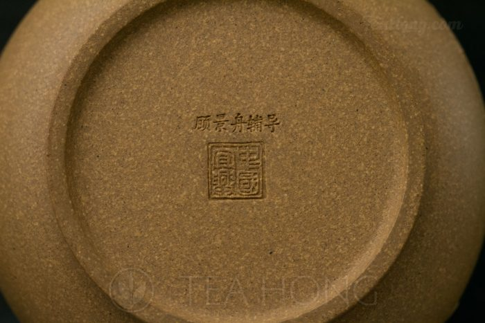"Underside of the pots is seal marked with the characters ""Yixing China"" and the supposed guidance of legendary modern pot masters."