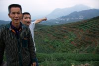 Young Master Wang pointing at Nanyan, the legendary seat of the