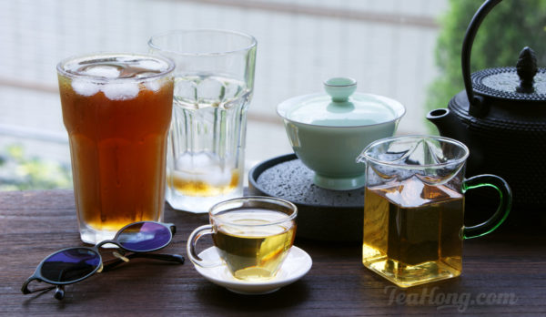 two glasses of ice tea and a gaiwan with freshly brewed tea